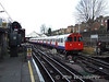 Bakerloo line trains comes out of the reversing siding at Queens Park. Sat 26.01.08
