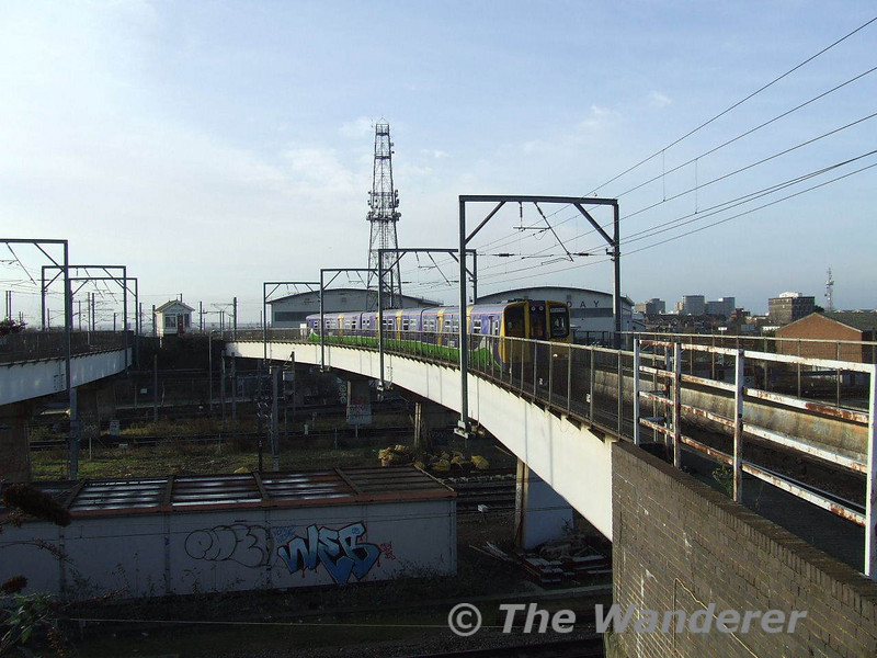 Willesden Junction as a Richmond - Stratford service crosses the West Coast Mainline. Sat 26.01.08