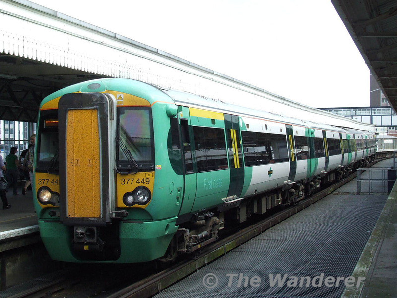 377449 arrives at Portsmouth Harbour with the 1012 from Brighton. Sun 24.05.09