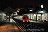 A District Line train to Embankment at West Kensington. Sat 20.11.10