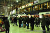 Passengers mingle around the departure boards at London Waterloo waiting for their train home. Sat 20.11.10