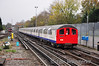 The 62 stock Sandite train passes Woodford running from Leytonstone to Epping. Sat 20.11.10