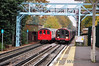Old and New Central Line trains past each other at Snaresbrook. Sat 20.11.10