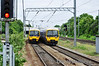 166208 & 166220 pass each other at Ealing Broadway.  Sun 15.05.11