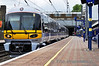 332007 passes Ealing Broadway with a Heathrow Express service to London Paddington.  Sun 15.05.11