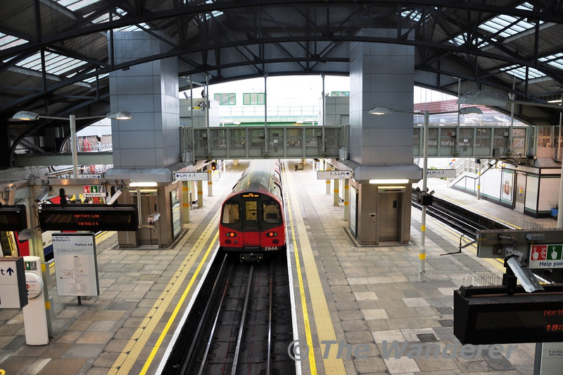 A view of Morden Station from the footbridge as 51666 brings up the rear of a train to Edgware via Bank. Sun 15.05.11