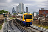378151 arrives at Hoxton with the impressive City of London skyline in the backround. Sun 15.05.11