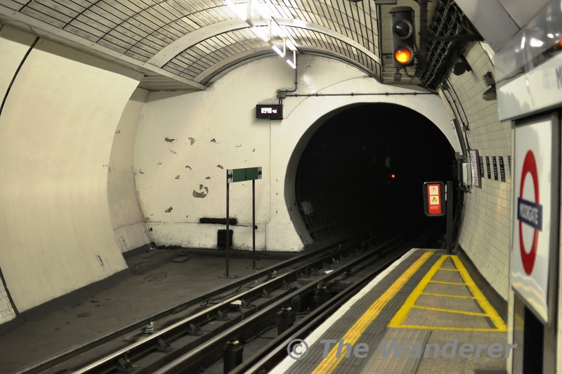At the southbound platform on the Northern Line at Moorgate this unusual layout exists with the track turning right but the station bore continues straight on.  Mon 16.05.11