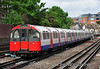 73 stock Driving Motor 109 brings up the rear of a Westbound Piccadilly Line train departing Barons Court. Sat 09.06.12