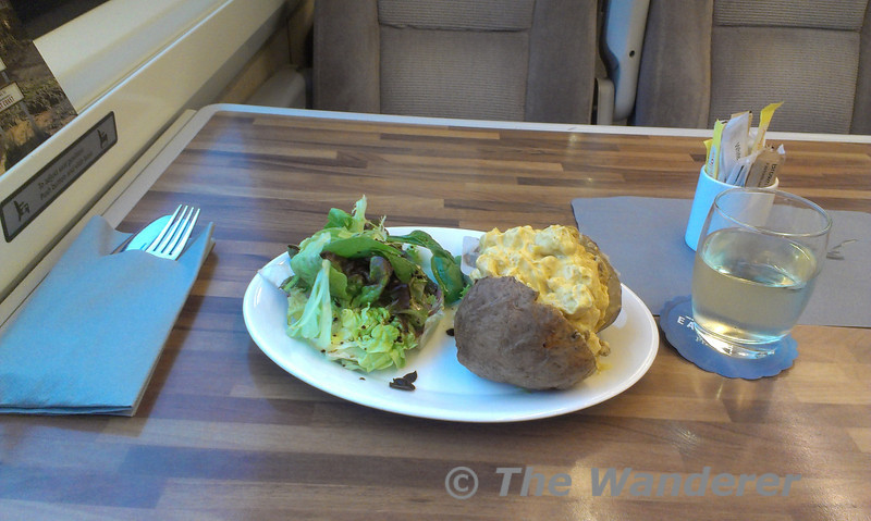 The First Class complementary evening meal on East Coast Trains. Jacket potato with coronation chicken garnished with mixed leaf salad and balsamic dressing. Fri 08.06.12