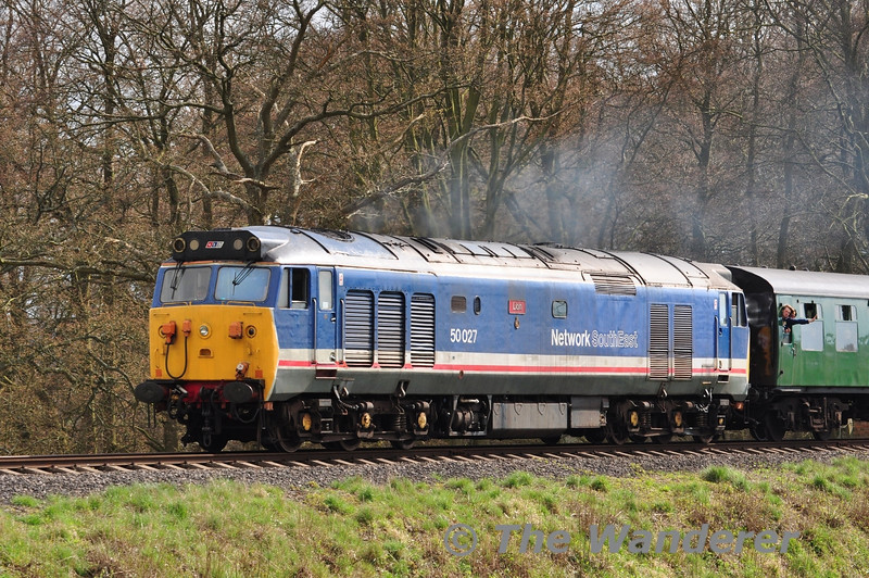 50027 in revised Network South East livery passing Rookwood Lane with the 1545 Alresford - Alton. Sat 27.04.13