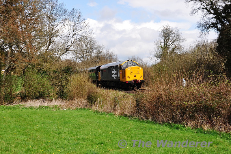 37901 slugs its way up the grade out of Alton and is passing over Bricklin Lane Bridge with the 1330 Alton - Alresford. Sat 27.04.13