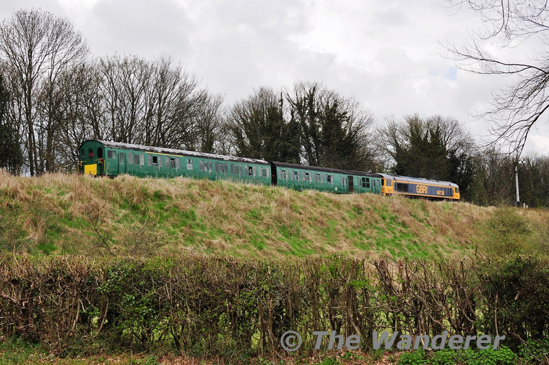The very unusual combination of 66738 + 1125 departing Alresford with the 1254 to Ropley. Sat 27.04.13
