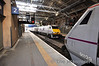 82214 departs Edinburgh with the 1730 to London Kings Cross. 91129 has just arrived with the 1300 from London. Sun 28.04.13