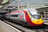 The pioneer of the Virgin Pendolino fleet; 390001 stands at Manchester Piccadilly with the 1220 to London Euston. Mon 27.05.13