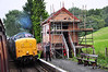 The signalman prepares to exchange tokens with the crew of 55002 as it arrives at Hamton Loade with the 1040 Kidderminster - Bridgnorth.  Thurs 03.10.13