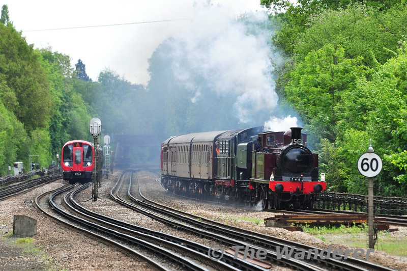 The delayed 1245 Harrow-on-the-Hill - Amersham passes Moor Park led by Met No. 1 with GWR Pannier Tank 9466 behind. Also in the consist is No. 12 Sarah Siddons. Sat 25.05.13