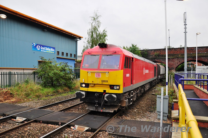 Running 68 minutes early and catching me out as a result as it passed Altrincham was 60020 working 6N49 1047 Oakleigh Sidings - Tunstead Sidings. Wed 02.10.13