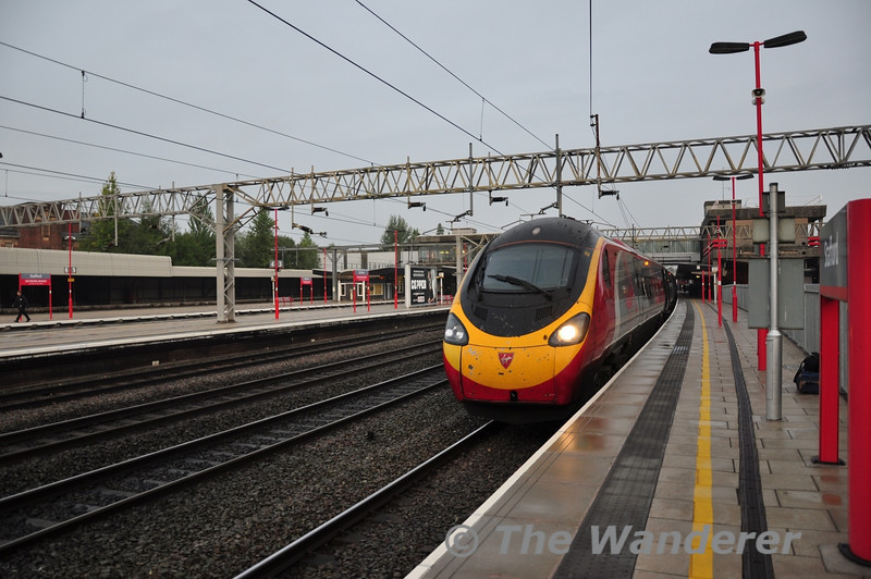 390123 at Stafford with the 0643 Manchester Piccadilly - London Euston. Thurs 03.10.13