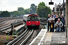 Enthusiasts wait for the arrival of Met 1 as a Piccadilly Line train passes non-stop. Sat 09.08.14