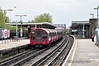 91097 at the rear of a Central Line train at Leytonstone. Wed 23.04.14
