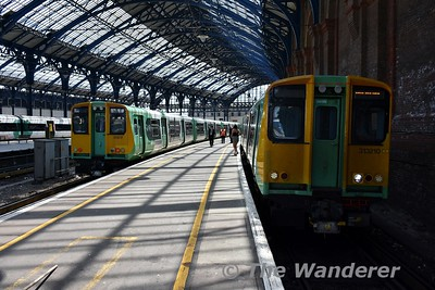 313210 and 313217 at Brighton with the 1302 to Portsmouth Harbour and 1252 to West Worthing. Wed 23.05.18