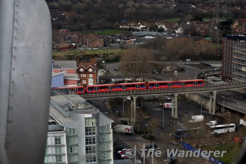 A DLR train heads along the Beckton Branch as EI-RJO prepares to land at London City. Thurs 15.03.18