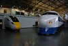 Shinkansen Leading Car 22-141, 'bullet train', built by West Japan Railways, 1976, withdrawn from service in October 2000 is now on display in the Great Hall at the National Railway Museum. In the backround is a cab mockup of the new Class 800 IEP trains. <br /> Sat 08.09.18