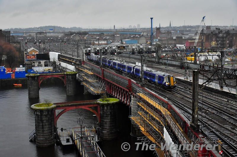 The view from the hotel room in Jurys Inn Glasglow. 380111 arrives into Glasgow Central with the 1228 Neilston to Glasgow Central. Tues 26.11.19