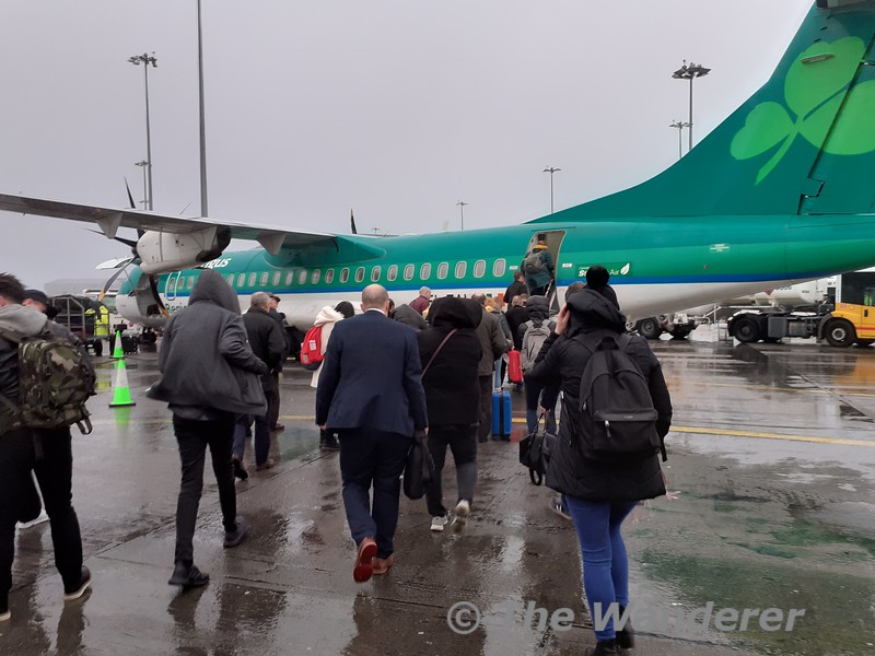 Passengers for EI3224 hustle to EI-FAW in dreadful weather at Dublin Airport for their flight to Glasgow. Tues 26.11.19