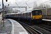 318253 leads a sister unit into Partick with the 1121 Motherwell to Milngavie. Sun 09.02.20