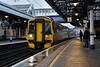 158718 + 170419 arrive at Stirling with the  1545 Dundee to Glasgow Queen Street. Sun 09.02.20