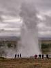 Iceland, Geysir - Geysir erupting while a crowd looks on