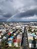 Iceland, Reykjavik - Rainbow over a neighborhood of colorful houses