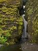 Iceland, Gljúfurárfoss - Mysterious waterfall visible through a crack in the rock