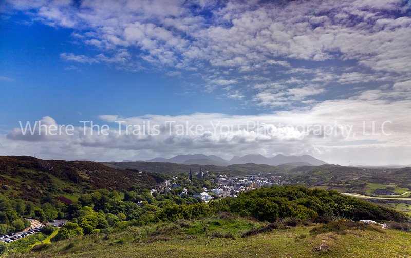 """95 View Over Clifden, Connemara County, Ireland - three of us mucked our way through a very muddy road and then up a short but somewhat steep hill to capture this view of Clifden and the """"12 Pins"""" beyond."""