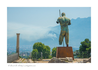 Bronze statue looking out over Gulf of Naples, Pompeii, Italy