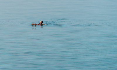 Floating in the Dead Sea.  Dead Sea, Jordan.