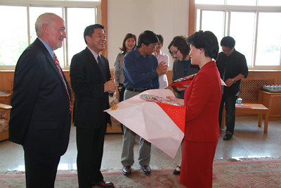 Susin Seow receives an elegant silk dress gift from Mr Wang.