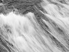 Norway, Nigardsbreen - Close up of waterfall flowing over granite, black and white