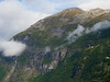 Norway, Geirangerfjord - Top of mountains above the fjord with a few houses perched up high