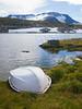 Norway, Jotunheimen - Boat alongside lake with distant mountain