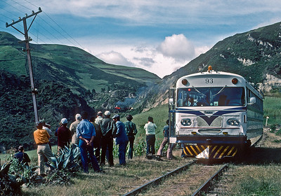 July 1976.  Our chartered railbus has pulled into a siding to meet a train, and our group is watching the train disappear into the distance.