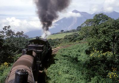 November 1971.  Climbing Palin Hill between Esquinta and Palin Pass.  In the background is Volcan de Fuego, and behind it Volcan de Acatenango.