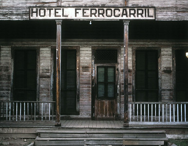 """The Hotel Ferrocarril at Zacapa.  This was part of the station complex , and provided both a lunch room for through Puerto Barrios-Guatemala City passengers as well as a hotel for passengers waiting for the overnight connection to the train to San Salvador.  Staying at the hotel was described by one wag as """"like spending the night in a yard office"""" since the upstairs veranda overlooked the yard.  The hotel obviously had not been painted in years but was clean and had a decent dining room and bar."""