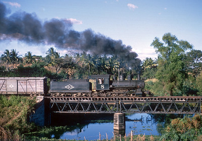 January 1968.  The afternoon mixed from Sonsonate to Sitio and on to San Salvador crosses one of the many bridges built from welding rail into trusses.