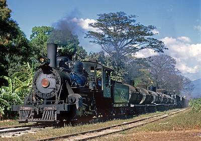 January 1968.  The 112 leads a freight from Sonsonate to the new port at Acajutla.