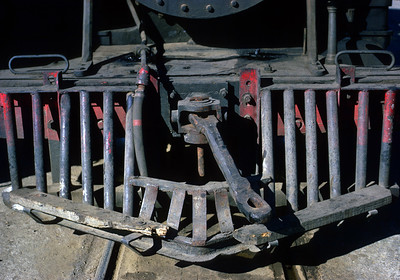 The FES operated with a mixture of knuckle and link and pin couplings.  The tenders on the original FES engines had been equipped with knuckles, but the pilot beams still had these ancient long links for link and pin operation.  January 1968.