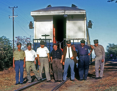 March 1970.  This was the crew on our two car chartered train from Guatemala City to Zacapa.  We were well cared for by the Trainmaster, Road Foreman of Engines, Engineer, Fireman, Conductor and two brakemen.  Third from the left is the Jefe de Trenes, Herminio Salguero.  He took care of us on most of our later charters.