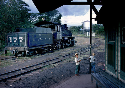 March 1970.   A few days later while chasing trains by auto from Guatemala City we found 177 at Santa Maria.   Santa Maria was where the grade began to Palin Pass, and the 177 is probably waiting its turn to help a freight up the hill.  It was also the junction of the line to Puerto San Jose, which was the first rail line built in Guatemala.